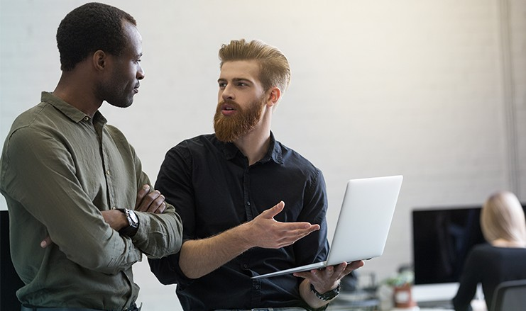 two young smart business men discussing new project