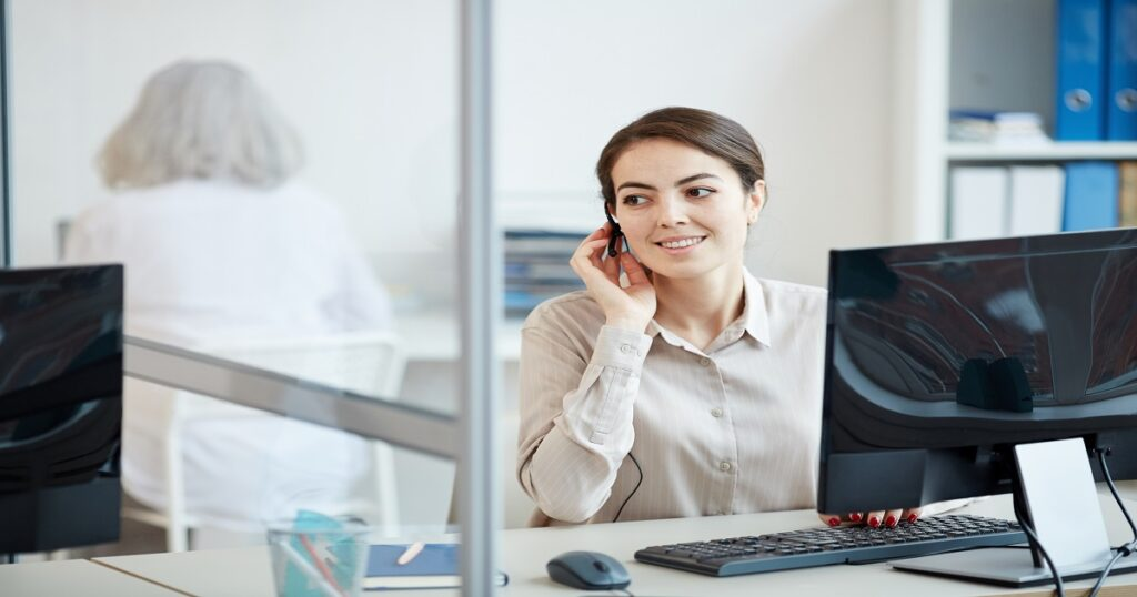 Secretary Wearing Headset at Workplace