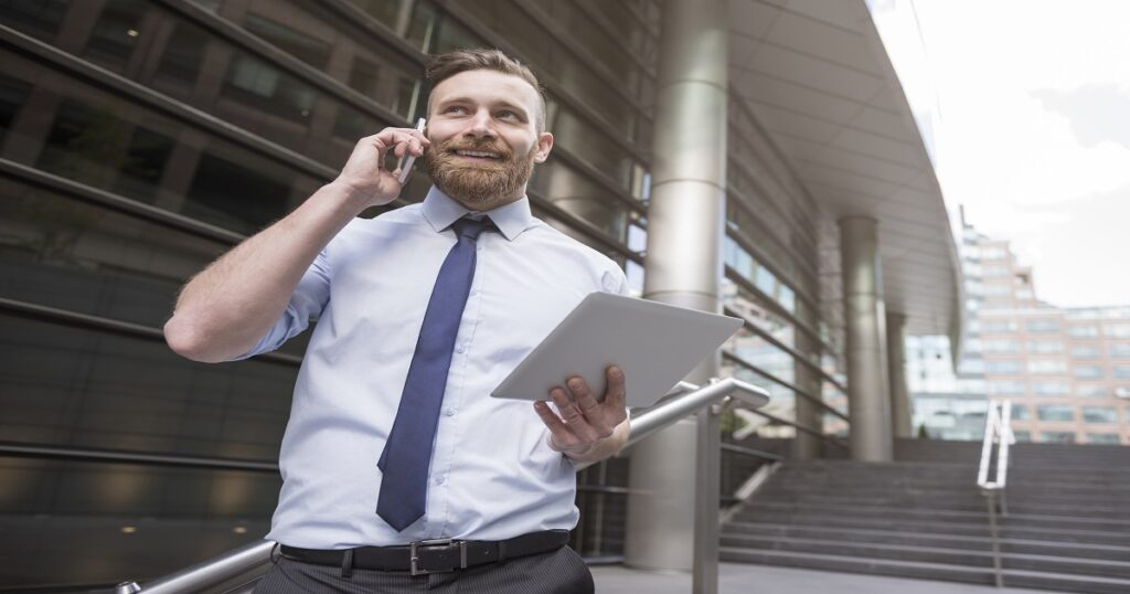 talking on a mobile phone out of the office