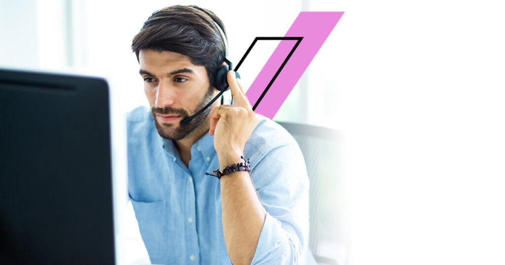 Portrait of handsome male customer service in headphones. Call center staff speaking with head set in modern office