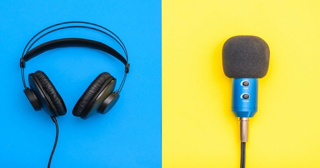 Black headphones and blue microphone