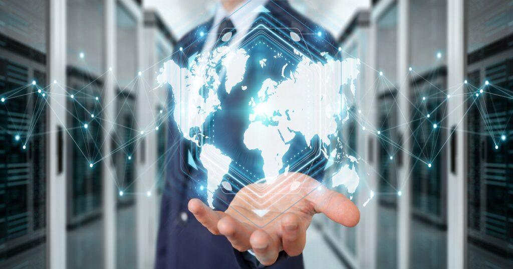 Businessman using digital world map