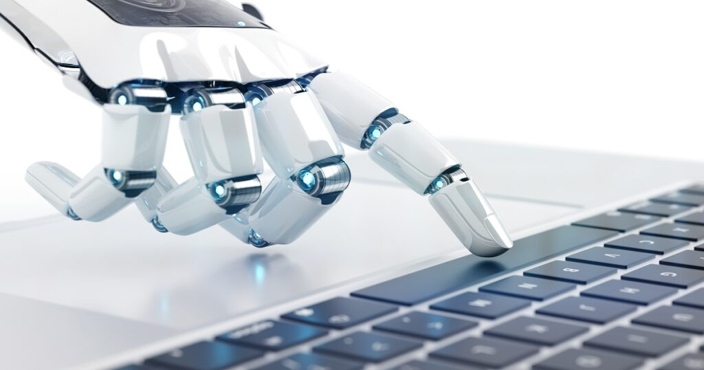 White robot cyborg hand pressing a keyboard
